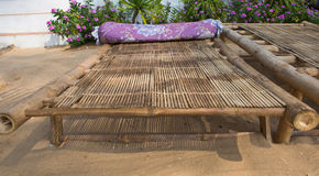 Close up of a bamboo sun bed on a tropical beach Royalty Free Stock Image