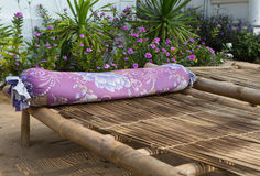 Close up of a bamboo sun bed on a tropical beach Royalty Free Stock Images