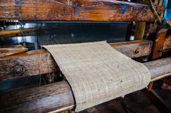 Close up of bamboo threads weaving on the manual wood loom Royalty Free Stock Photo
