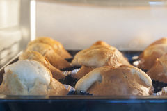 Close up banana cupcake in oven. During cooking Stock Photo