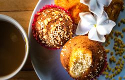 Close up, banana cupcakes with white sesame seeds and peanuts topping and fried chicken served with coffee in the morning. Banana cupcakes with white sesame stock photos