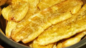 Close up banana fried on the steel plate. Selected focus. stock image