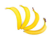 Close-up bananas isolated over the white background. Appetizing tropical fruits. Four bright yellow bananas. Vegetarian lifestyle. Stock Photos