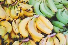 Close up of bananas on market stand Royalty Free Stock Photo