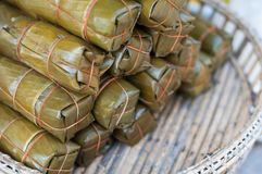 Close up Bananas with Sticky Rice pack on wood basket wicker market, Khao Tom Mud, blur background royalty free stock photos