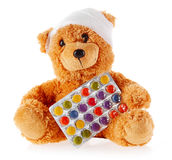 Close up Bandaged Teddy Bear with Foil of Tablets Royalty Free Stock Photography