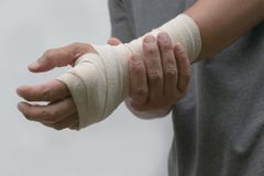Close-up bandaged wrist men`s pain his hand after work. stock images