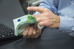 Close-up of bank clerk counting euros Stock Image