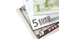 Close-up of banknotes (dollar, euro, yuan). In a separate white background Royalty Free Stock Photo