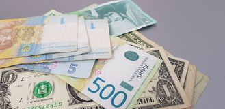 Close up of banknotes of hryvnia dynars and dollars stock photography
