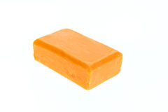 Close up bar of orange carrot soap isolated on white Stock Photography
