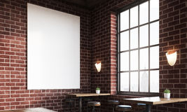 Close up of bar with poster and large windows Stock Photo