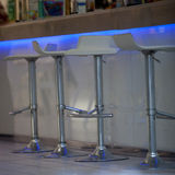 Close-Up of Bar Stools at Illuminated Bar Stock Images