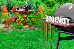 Close-up Of Barbecue Grill With Tools And BBQ Party Sign Royalty Free Stock Photos