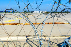 Close-up of a barbed wire fence. Horizontal view of a barbed wir Royalty Free Stock Images