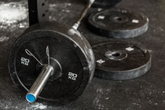 Close-up of barbell. Close-up of heavy barbell on the gym floor royalty free stock photography