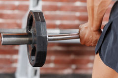 Close up of barbell lifting by man Royalty Free Stock Photo