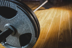 Close up of barbell. On wooden floor royalty free stock image