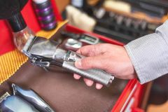 Close up of barber hand picking hair clipper at barber shop. Close up of barber hand picking hair clipper at barber shop stock photo