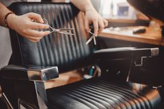 Close-up of barber holds clip-on hair clipper barbershop. Close-up of barber holds clip-on hair clipper barbershop royalty free stock images