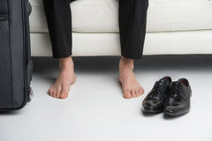 Close up of bare feet of a business man. Royalty Free Stock Photo