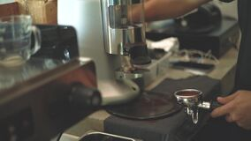 Close up on barista hand making coffee in coffee shop, slow motion 120fps stock footage