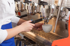 Close-up of barista making coffee stock images