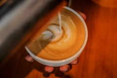 Making a latte Art royalty free stock photos