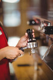 Close up of a barista pressing coffee Royalty Free Stock Photo