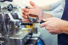 Close up Barista take coffee grind in group, Prepare to brewing espresso shot. Selective focus. Space for text.  Royalty Free Stock Photos