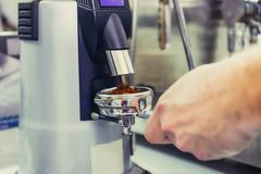 Close up Barista take coffee grind in group, Prepare to brewing espresso shot. Selective focus. Space for text.  Royalty Free Stock Images