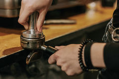 Close-up of barista temping coffee Stock Images