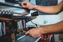 Close-up of barista using espresso machine at coffee house Royalty Free Stock Photos