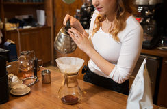 Close up of barista woman making coffee Stock Photo