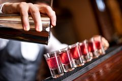 Close-up of barman hand pouring alcohol royalty free stock photos