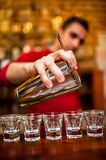 Close-up of Barman pouring alcoholic drink and cocktails Royalty Free Stock Photo