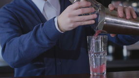 Close Up Of Barman Pouring Cocktail Into Glass stock video footage