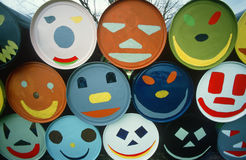 Close up of barrels with happy faces. Happy faces painted on barrels in Eastern Shore, Maryland Stock Photo