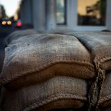 Close-up of the Barrier at Check Point Charlie in Berlin at Dusk. Sandbag Barricade at CheckPoint Charlie at Dusk royalty free stock image