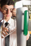 Close-up of bartender holding glass at beer dispenser Royalty Free Stock Images