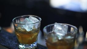 Close up of a bartender pouring a drink into a shot cup stock video