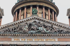 Close-up of the bas-relief above the entrance to the St. Isaac`s Cathedral is the largest Orthodox church in St. Petersburg Stock Photo