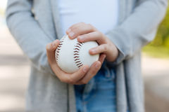 Close up of baseball ball that being in hands Royalty Free Stock Photo