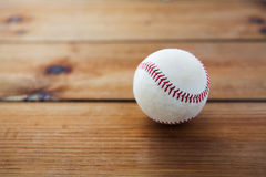 Close up of baseball ball on wooden floor Stock Photo