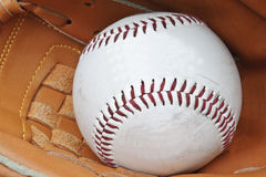 Close up of baseball in catcher's mitt Stock Images