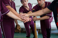 Close up of baseball team doing high five. While standing at locker room royalty free stock photography