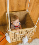 Close-up, in the basket of the balloon plays a boy baby Royalty Free Stock Image