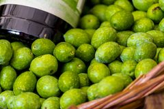 Close up of a basket of green olives Turin, Piedmont, Italy. Close up of a basket containing green olives and a bottle of olive oil, basic condiment of Royalty Free Stock Photo