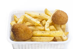 Close up of basket of fries and arancini Stock Photos