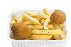 Close up of basket of fries and arancini Royalty Free Stock Images